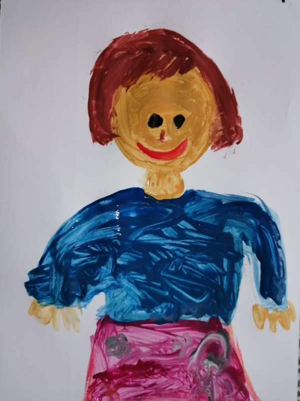 Portret patronki szkoły Agnieszki Bartol, wykonany na kartce farbami przez jednego z uczniów.