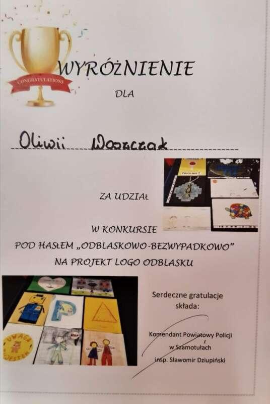Dyplom wyróżnienia dla Oliwii Woszczak w konkursie organizowanym przez Komendę Powiatową Policji w Szamotułach